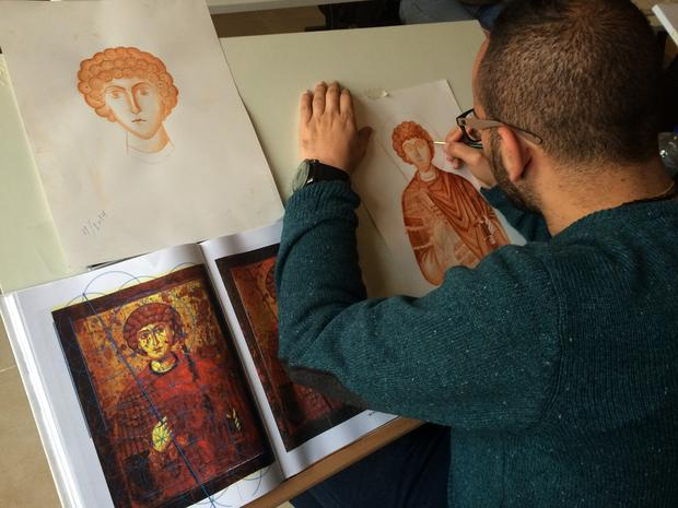 Nicola Juha draws an impression of a Byzantine Orthodox icon (MEE/Alex Shams)