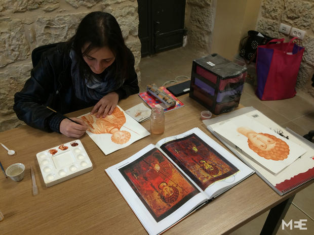 A student draws an impression of a Byzantine Orthodox icon (MEE/Alex Shams)